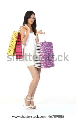 Modern girl with lots of shopping bags - stock photo