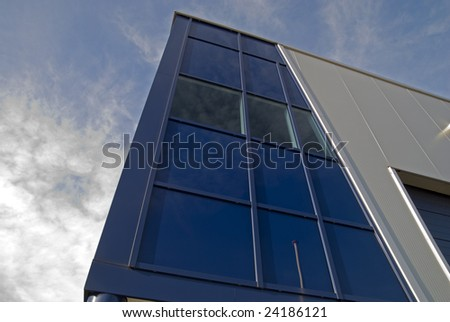 Modern glass architechtectural design commercial building - stock photo