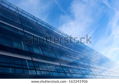 Modern glass architecture against blue sky - stock photo