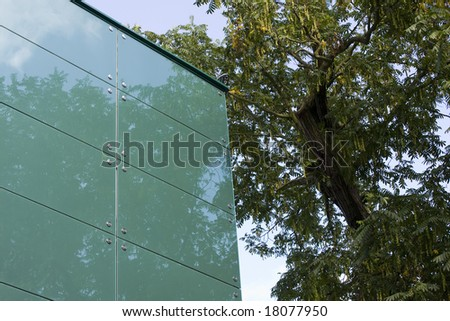 modern glass building and trees