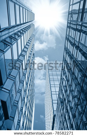 modern glass building under the sun in hong kong - stock photo