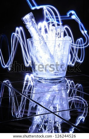 Modern glass jar with pieces of ice and blue light