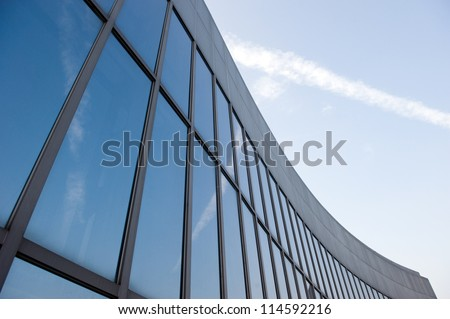 Modern glass silhouettes on modern building. - stock photo