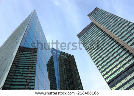 Modern glass skyscrapers in the city - stock photo