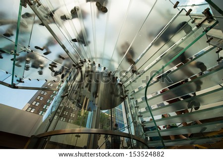 Modern Glass Staircase Silhouette of walking People in a modern interior. - stock photo