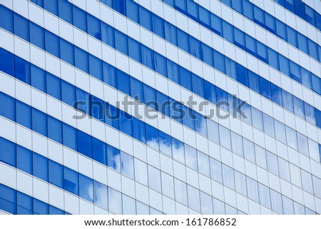 Modern glass with sky reflection  - stock photo