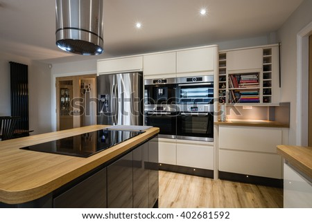 Modern Glossy Kitchen / A modern domestic kitchen with high gloss units, rounded corners and an island - stock photo