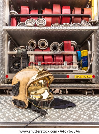 Modern Golden Fire Brigade Helmet and Other Inventory of a Fire Engine