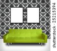 Modern green couch in a room with brocade wallpaper - space for copy in frames - stock photo