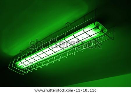 modern green neon power lamp, energy details - stock photo