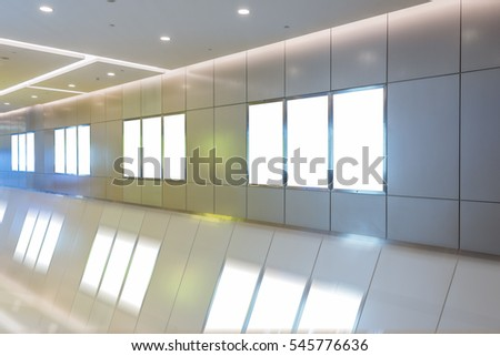 modern hallway of airport or subway station with blank billboards on wall.