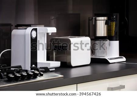 Modern hi-tek kitchen, clean interior design - stock photo