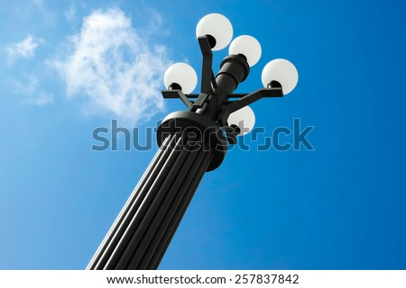 modern high lamppost, white lamps - stock photo