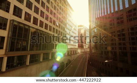 modern high rise buildings in financial business city district at sunset light. company office background - stock photo