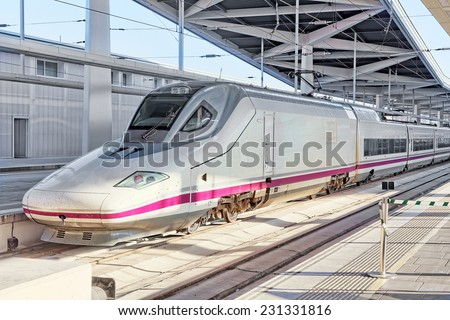 Modern high speed train at the railways stantion . - stock photo
