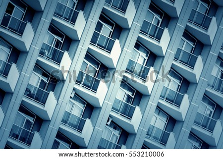 Modern highrise building with balconies, background. Toned