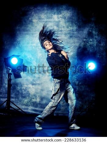 Modern hip-hop dancer over grunge background. - stock photo
