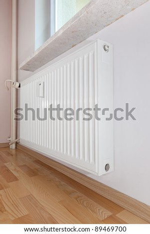 Modern home radiator - source of heat. - stock photo