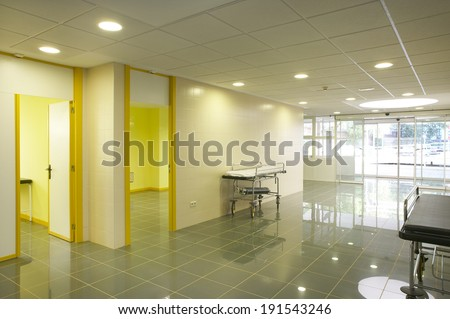 Modern hospital emergency entrance in yellow tone. Horizontal - stock photo