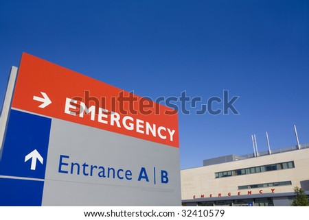 Modern hospital with emergency sign