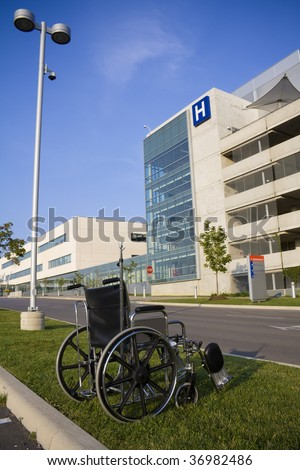 Modern hospital with wheelchair in foreground - stock photo