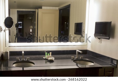 Modern Hotel Bathroom Environment Arranged in Pastel and Brown Colors. Horizontal Image Orientation - stock photo