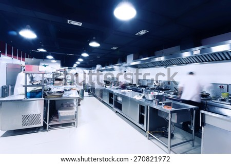 modern hotel kitchen and busy chefs. - stock photo