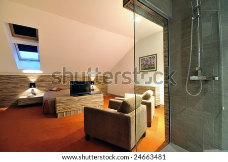modern hotel room apartment indoor with double bed and lcd tv - stock photo