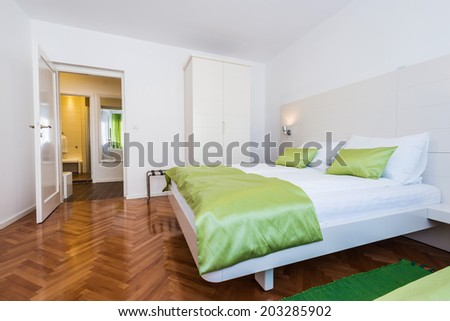 Modern hotel room wit bathroom - stock photo