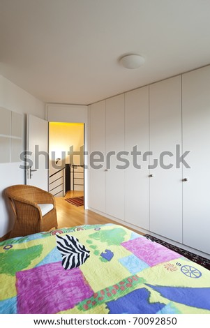 Modern house, bedroom with the modern furniture - stock photo