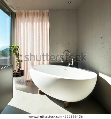 Modern house, detail bathroom, ceramic bathtub - stock photo