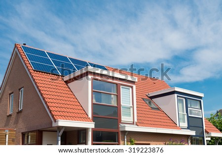 modern house in the netherlands with solar panels on the roof - stock photo