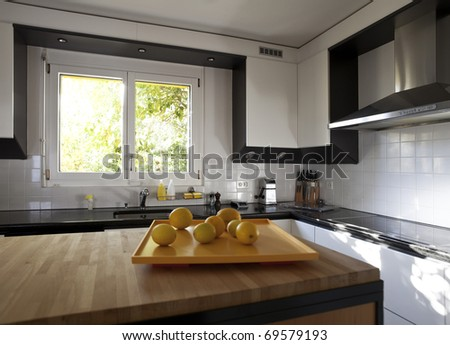 modern house, kitchen with the modern furniture - stock photo