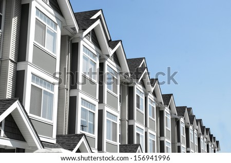 modern house of condominium rental and ownership property. building exterior and blue sky - stock photo