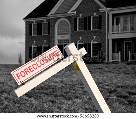Modern house with crooked foreclosure sign in suburbs - stock photo