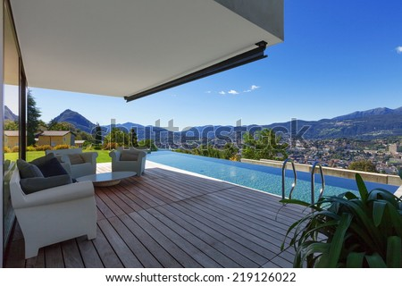 Modern house with infinity pool in exterior - stock photo