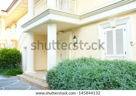 Modern house with landscaping on front - stock photo