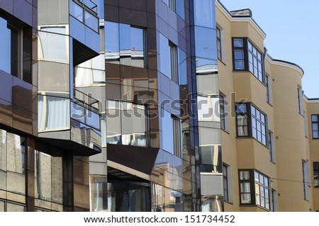 modern houses of reflecting in glass windows - stock photo