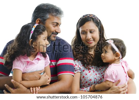 Modern Indian family with two daughter having conversation on white background - stock photo