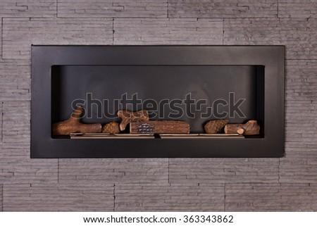 Modern indoor fireplace on biofuel. - stock photo