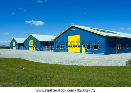 Modern Industrial distribution  delivery building in blue and yellow - stock photo