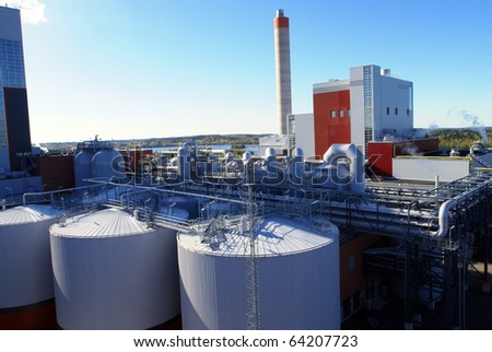 Modern industrial factory against blue sky