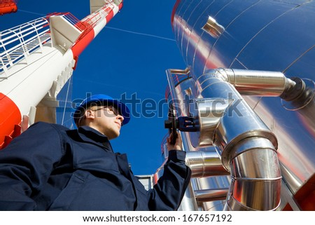 Modern Industry and Worker, industrial chimney and silo. Please see my other photo and videos with the same theme.  - stock photo
