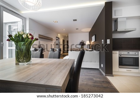 Modern interior design living room with dinning table - stock photo