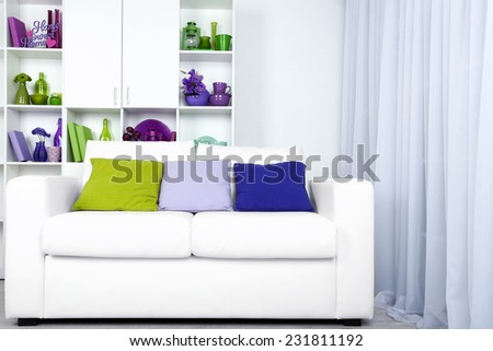 Modern interior design. White living room with sofa and bookcase - stock photo