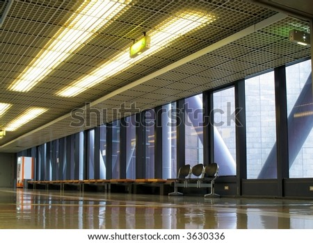 Modern Interior -- hallway and benches in a large public building - stock photo