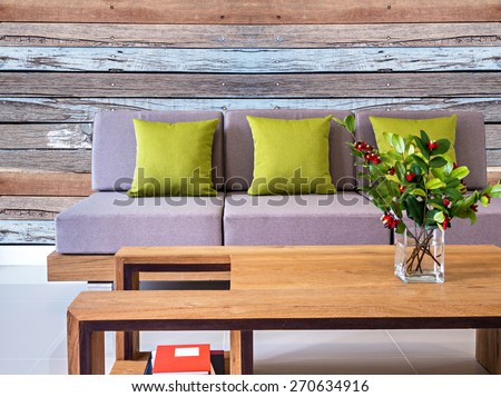 Modern interior Living room with sofa and rustic wooden wall background - stock photo
