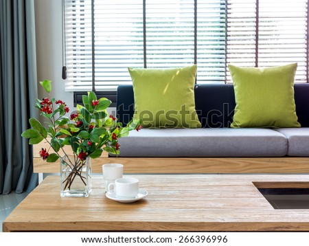 Modern interior of Living room with flower vase and sofa background - stock photo