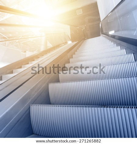 Modern interior with escalator close-up - stock photo