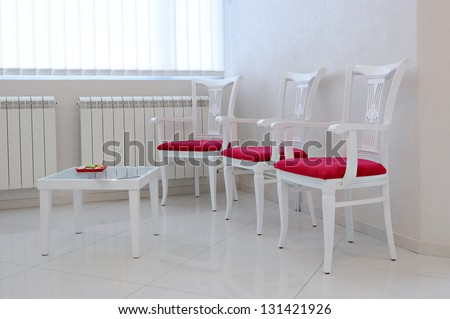 Modern interior with red chair and table-waiting room - stock photo